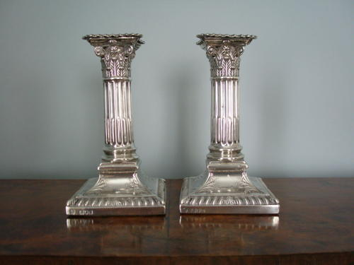 Pair of Victorian period dwarf silver candlesticks