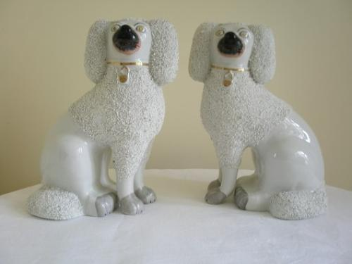 Pair of Staffordshire comforter Poodles