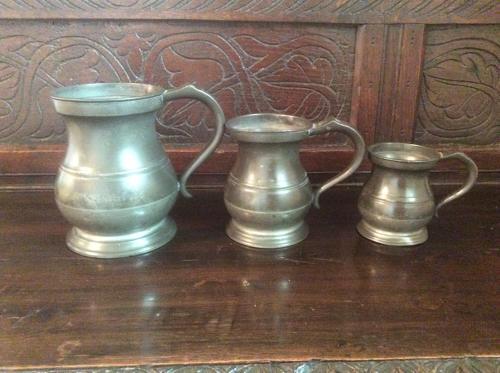 Set of three pewter  measures