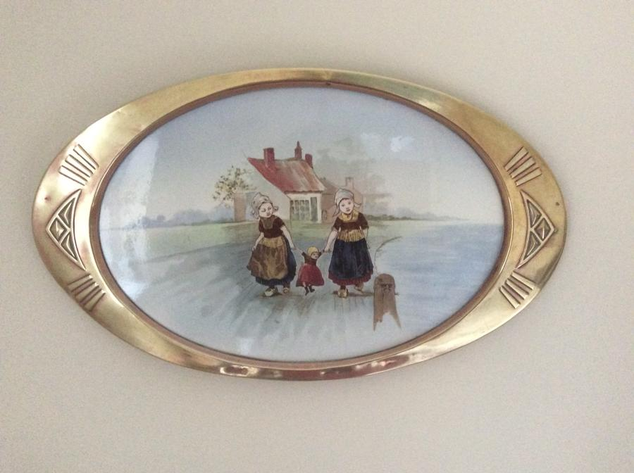 Art Deco painted ceramic plaque with brass surround