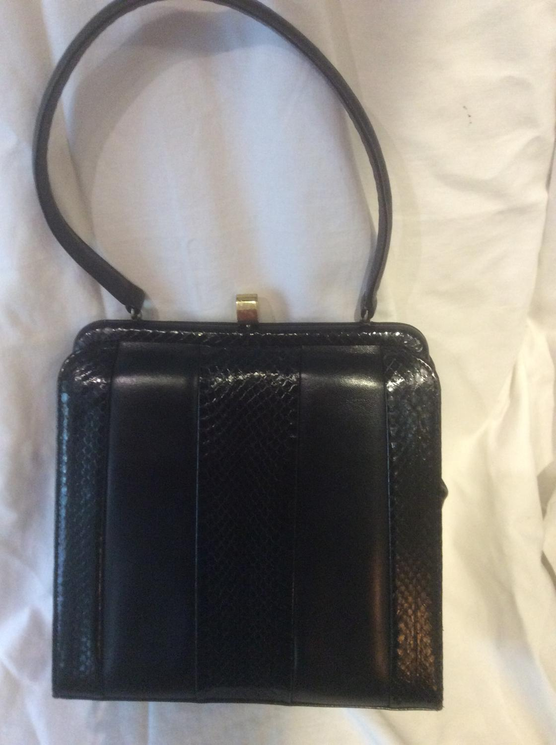 Good quality vintage navy leather handbag