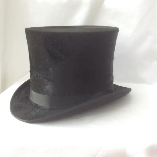 Black silk top hat and hat box