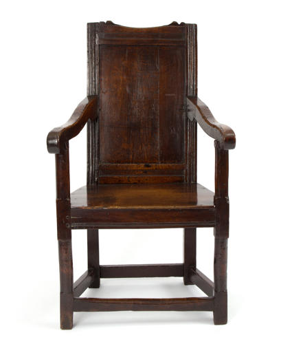 Late 17th century oak panel back wainscot chair