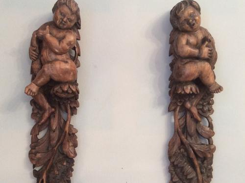 Pair of walnut 17th century putti carvings
