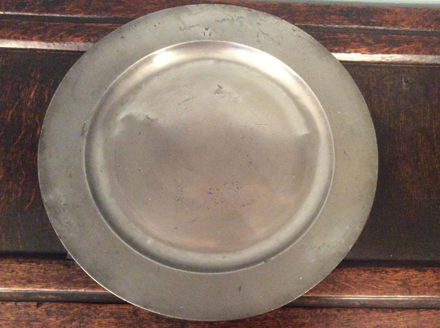 18th Century pewter charger with broad rim