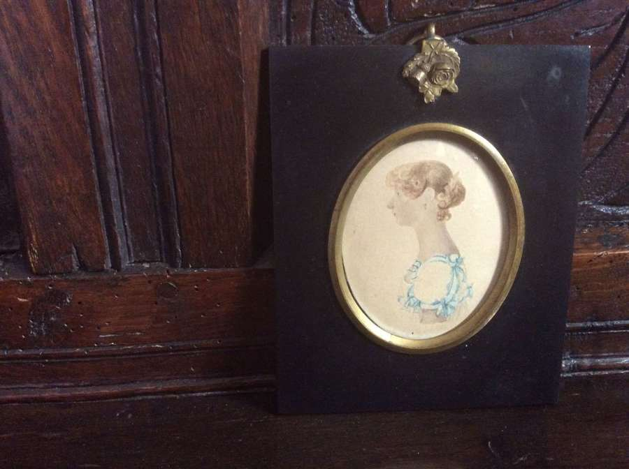 Regency period portrait miniature of a lady with blue ribbons