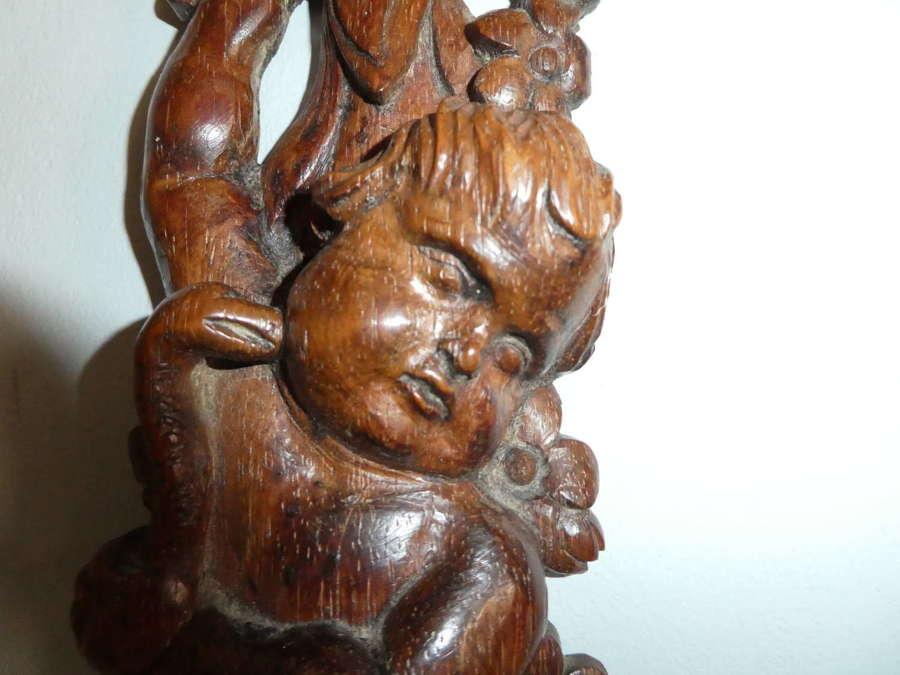 17th Century carved oak putti